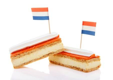20008557-two-traditional-dutch-pastry-called-tompouce-with-flags-over-white-background